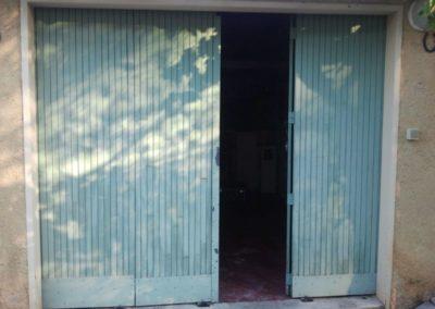 Remplacement de porte de garage à battants